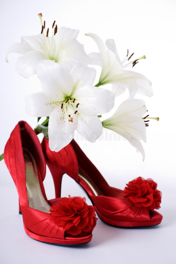 Red shoes and lillies stock images