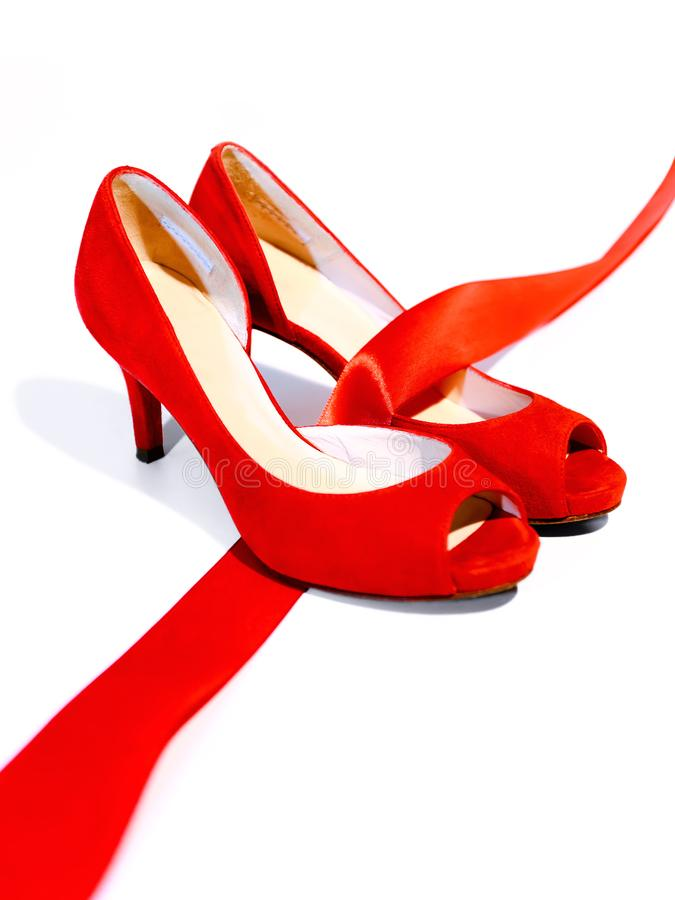 Red shoes, a symbol femicide royalty free stock image