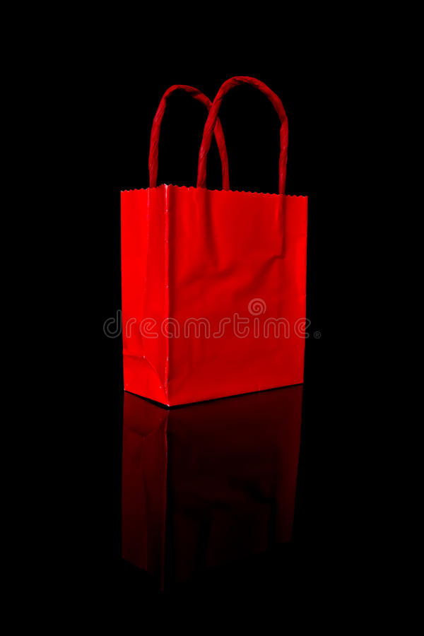 Red shopping bag on black royalty free stock photography
