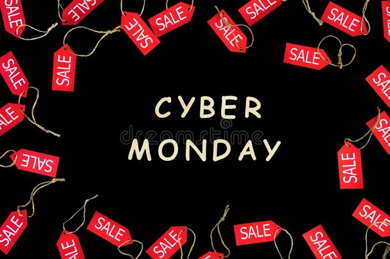 Cyber monday holiday. Red shopping sale discount labels. Red shopping sale discount labels on black isolated background with wooden text `Cyber Monday`. Fashion stock photos