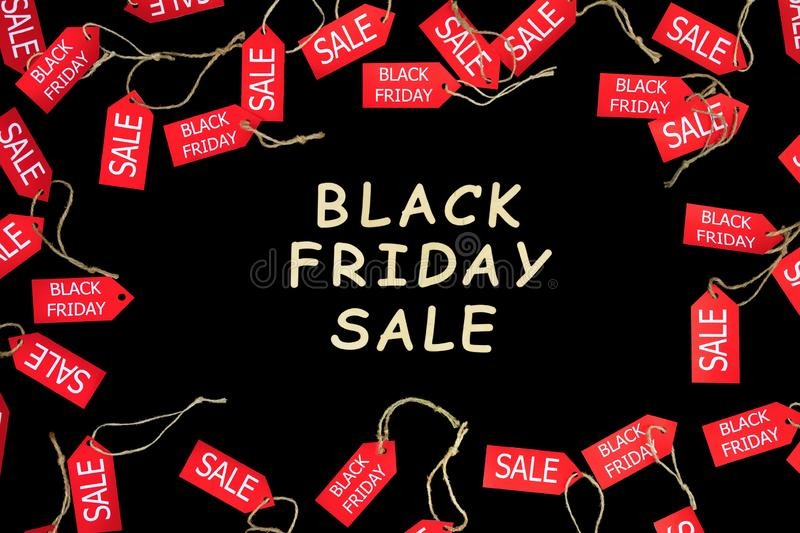 Fashion black friday holiday. Red shopping sale discount labels. Red shopping sale discount labels on black isolated background with wooden text `Black Friday stock photography