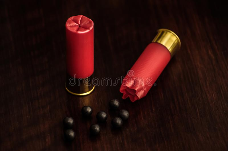 Red shotgun shells on a wooden surface royalty free stock photos