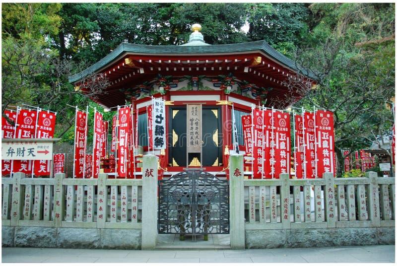 A red shrine by Hetsuno-miya Shrine. A little shinto red shrine by Hetsuno-miya Shrine on Enoshima island in Fujisawa, Kanagawa, Japan stock photo