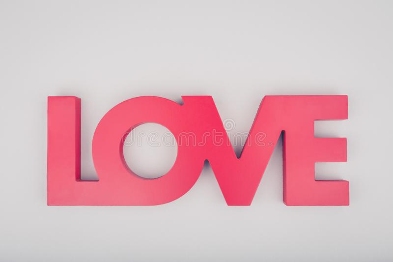 Red sign LOVE. Valentine day concept. Trendy minimalistic flat l. Ay design background. Horizontal royalty free stock photography