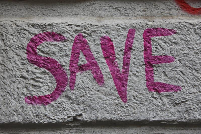 Save inscription on the stone concrete wall. SAVE/ graffiti royalty free stock photo