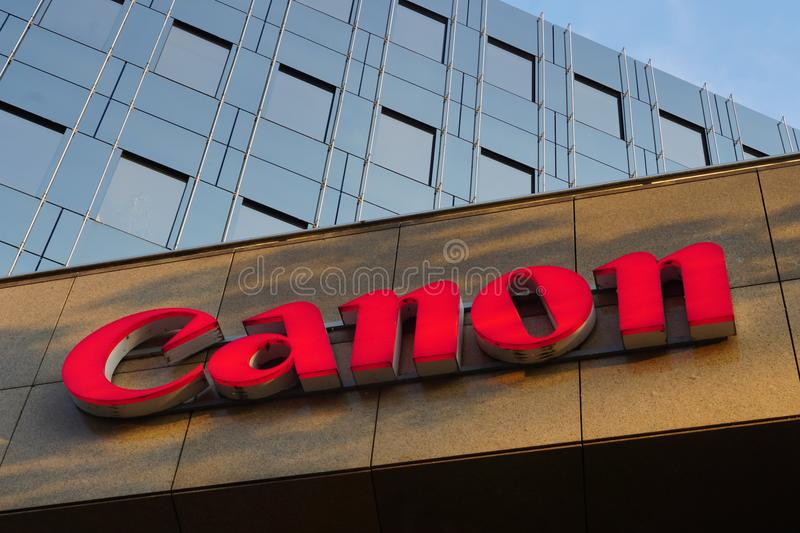 Red signage of the Japanese company Canon stock photos