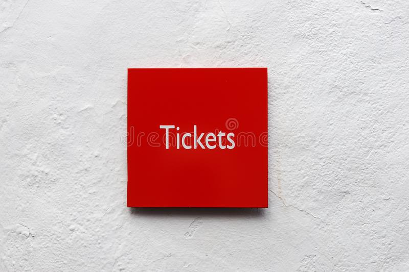 Red signboard with the word Tickets royalty free stock photo