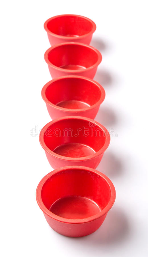 Red Silicone Muffin Baking Cup III. Red silicone muffin baking cup over white background stock images