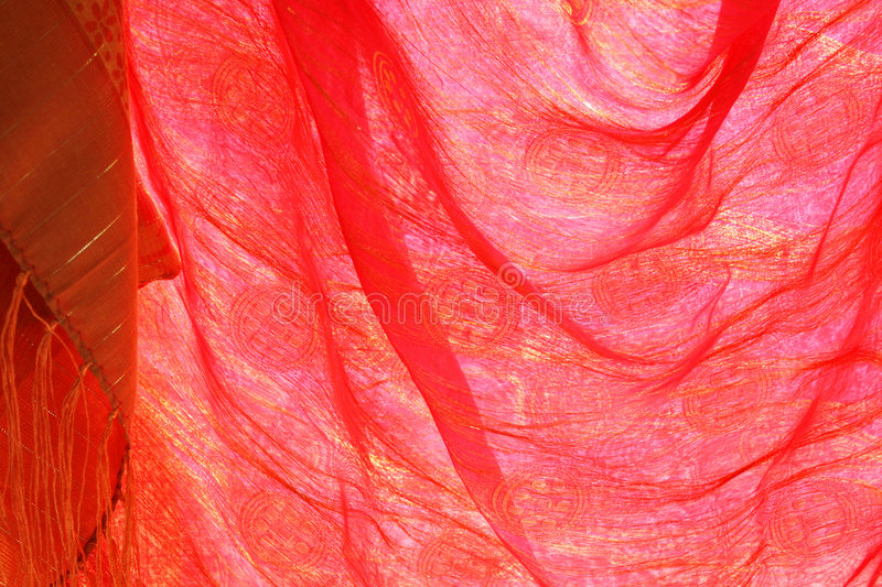 Red silk. Handwoven silk shawl in red, flowing softly as blown by wind. For web or print use stock image