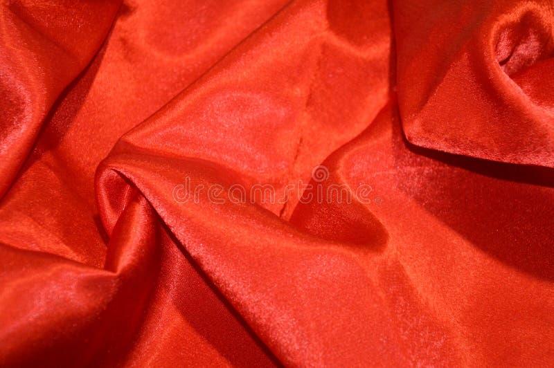 Red silk background. Textile satin stock photo