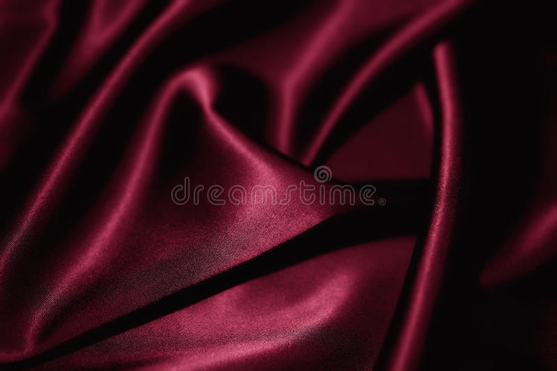 Red silk closeup. Texture of a red silk extreme closeup royalty free stock photos