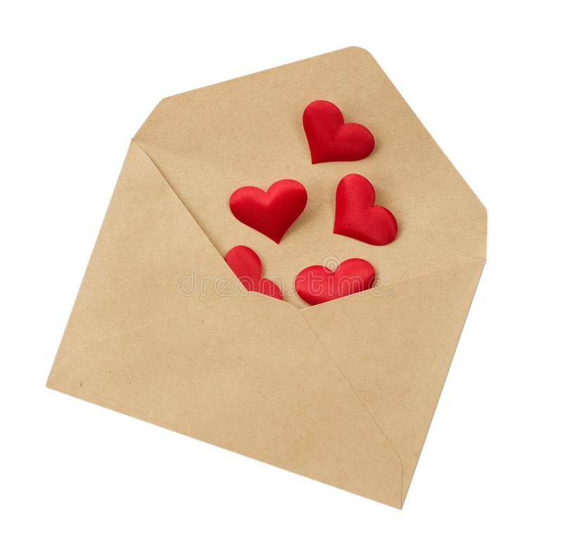 Red silk hearts in open postal envelope royalty free stock images