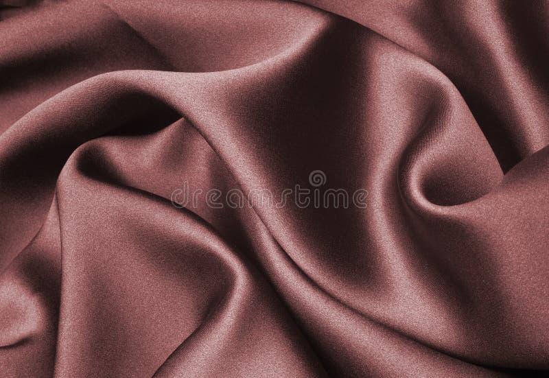 Red silk ribbon. Red silk waves - elegant back ground royalty free stock photos