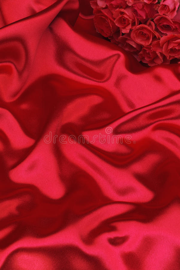 Red silk and roses royalty free stock photos
