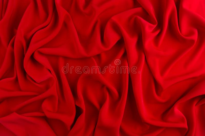 Red silk wavy background. Passion backdrop for Valentines day. Red silk wavy background. Passion backdrop for Valentines day stock photography