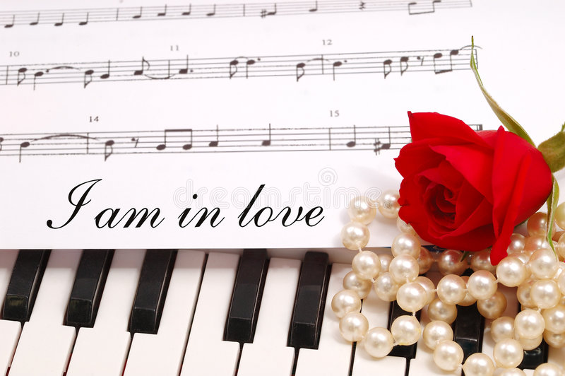 Red silky rose with musical notes stock photos