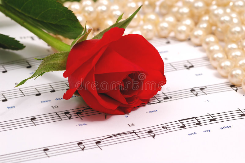 Red silky rose and pearls stock photo