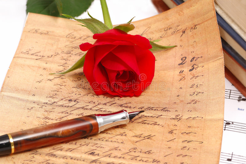 Red silky rose with a pen. Red silky rose with vintage pen and letter royalty free stock photography