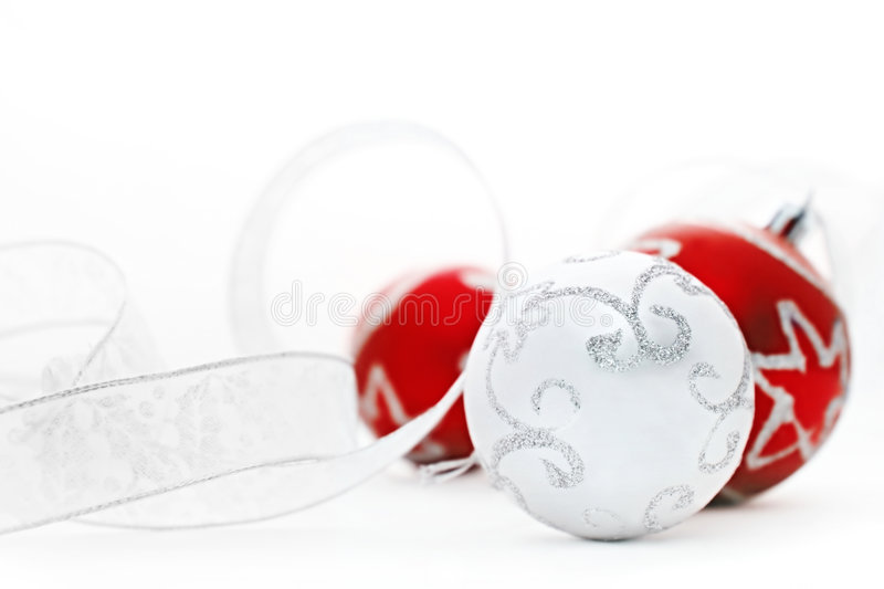 Red and Silver Baubles. Red and Silver Christmas baubles, with silver ribbon. Soft focus, shallow depth of field royalty free stock images