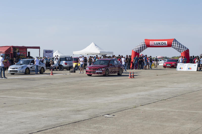 Red and silvery cars wait for team start on Resinge`s Drags stock photos