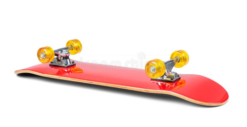 Red skateboard lies upside down wheels, isolated on white background. File contains a path to isolation.  stock images