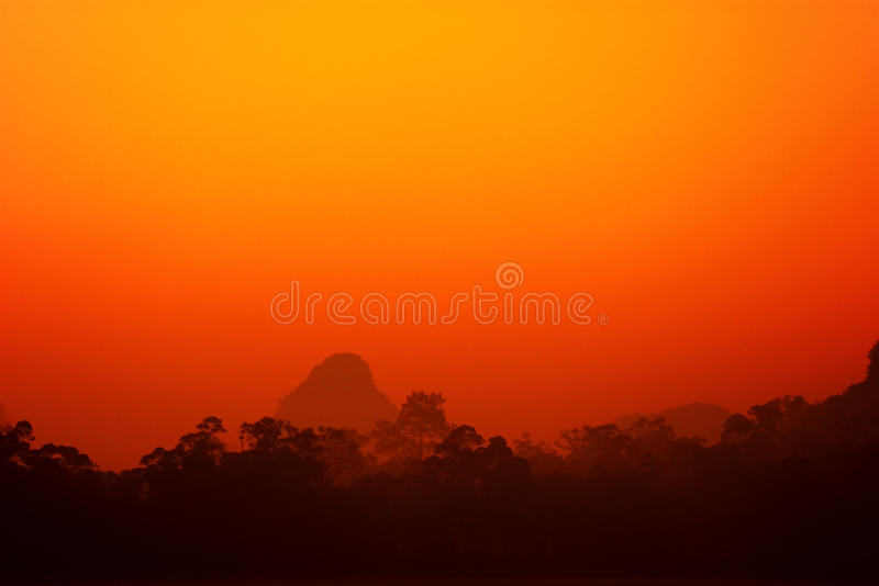 Red sky. The woods behind the mountains, the background is a beautiful pink clouds stock images