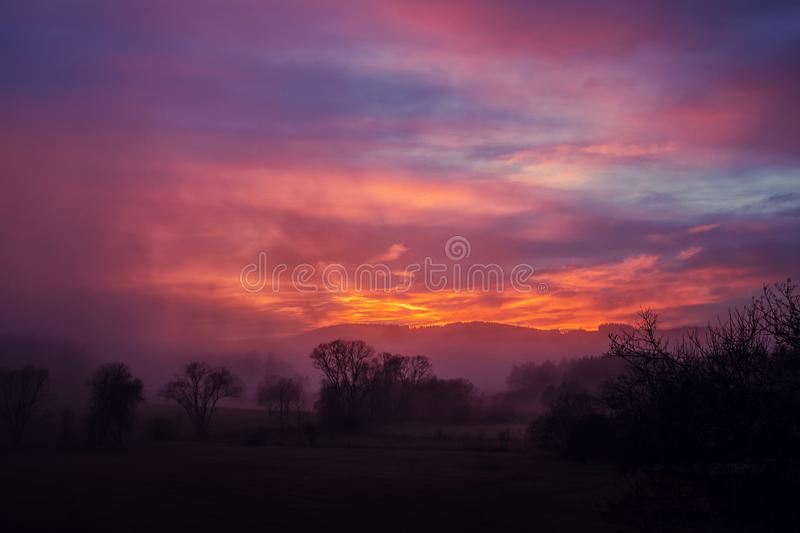 Red sky above hilly landscape royalty free stock image