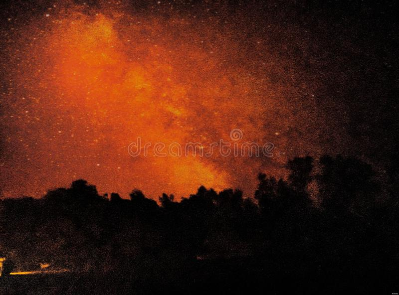 Red Sky in Low Light. Sky in Low Light. Awesome, colour, combination, different, amazing, trees, dark, bright royalty free stock photos