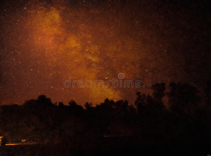 Red Sky in Low Light. Sky in Low Light. Awesome, colour, combination, different, amazing, trees, dark, bright royalty free stock image
