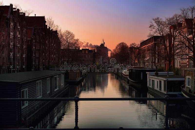 Red Sky over Amsterdam Canal Bridge royalty free stock photos