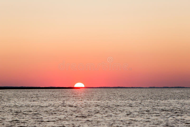 Red sky summer sunset. Sunset Atlantic Ocean Delaware bay royalty free stock photos