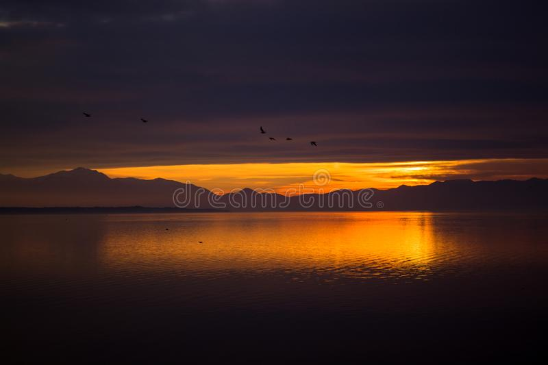 RED SKY SUNSET AND GODRAYS IN THESSALONIKI royalty free stock photography