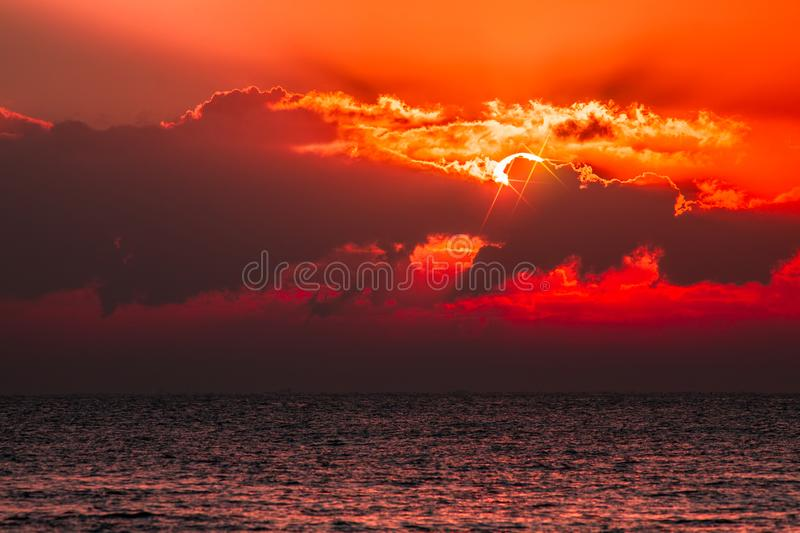 Red sky tropical sunset. Beautiful fantasy cloudscape with blood royalty free stock photography