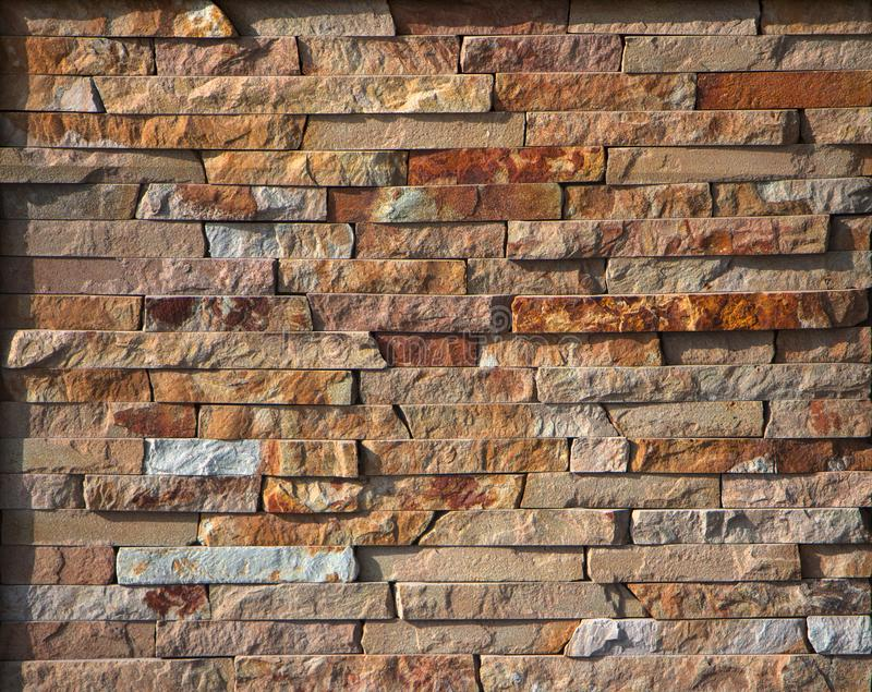 Red Slate Stone Wall background Texture. Close up stock images
