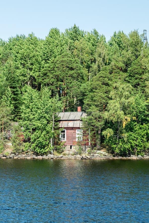 Red small finnish wooden house on island on the lake Saimaa. Lappeenranta, Finland.  stock image