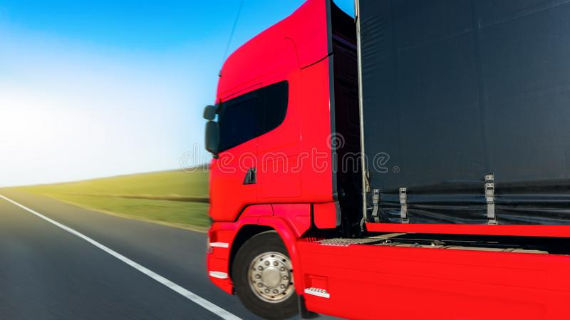 The red small weight begins the movement. Container of road cargo transportation. Commercial transport royalty free stock image