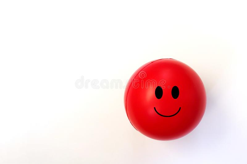 Red Smiling Emoji Ball against a White Background royalty free stock image