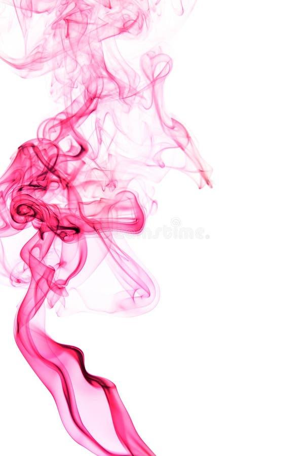 Red smoke on white background royalty free stock image
