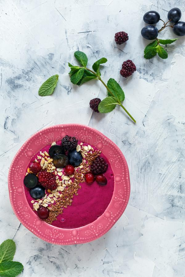 Smoothie bowl with red beets, berries and flax seeds. stock photography