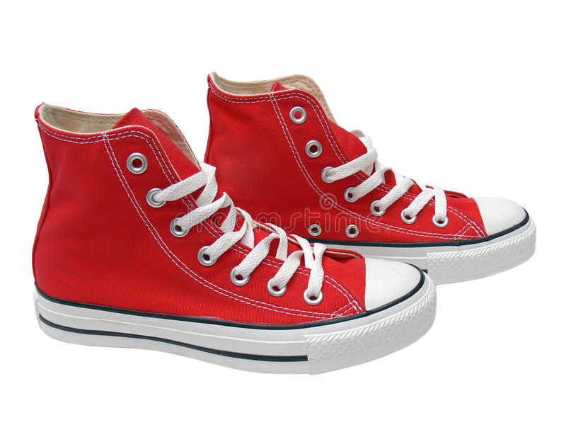 Red sneakers. Closeup of red sneakers isolated on white background royalty free stock photography