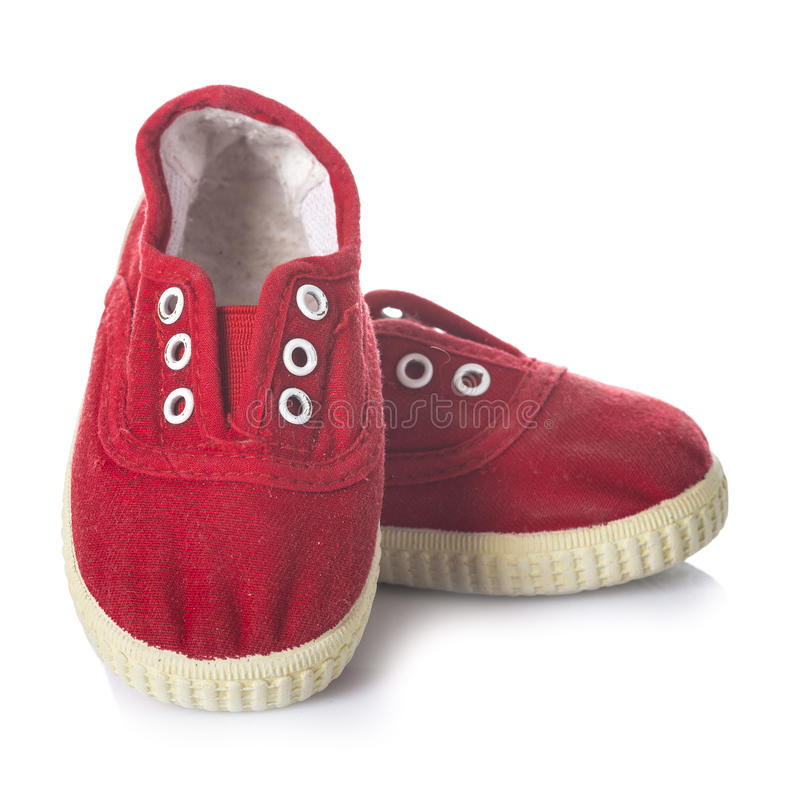 Red sneakers shoes for kids isolated on white background royalty free stock photo