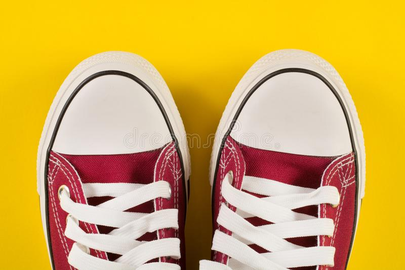 Red sneakers on old fabric retro background royalty free stock image