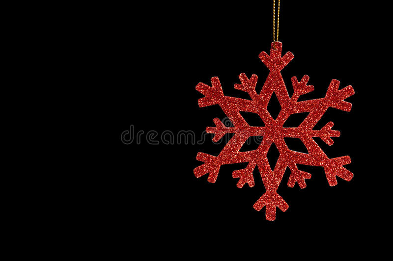 Red Snow Flake On A Black Background Royalty Free Stock Image