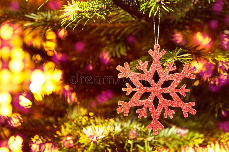 Download Red Snow Flake In A Christmas Tree Royalty Free Stock Photography - Image: 25584307