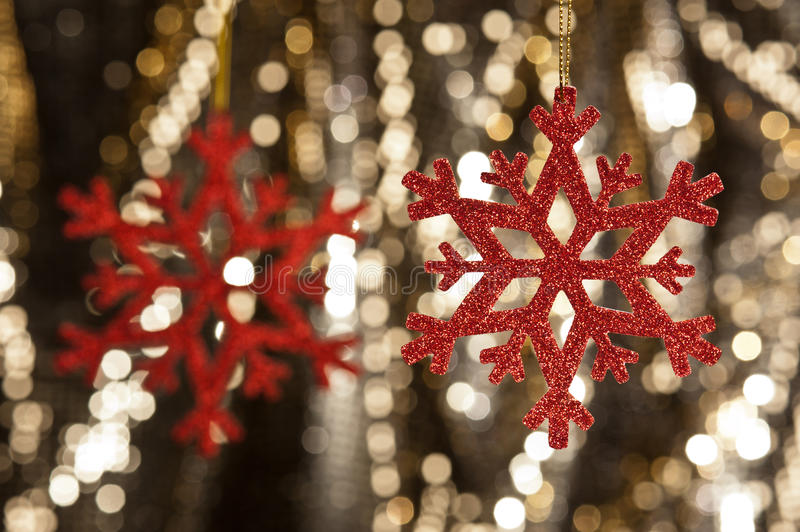 Download Red Snow Flake On A Gold Glitter Background Stock Image - Image: 24619289
