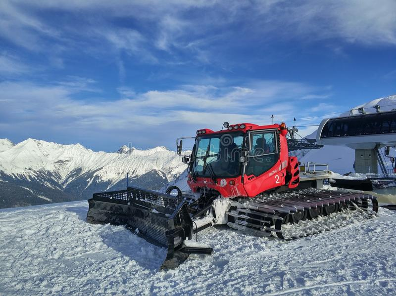 Red snowcat on the mountains royalty free stock images