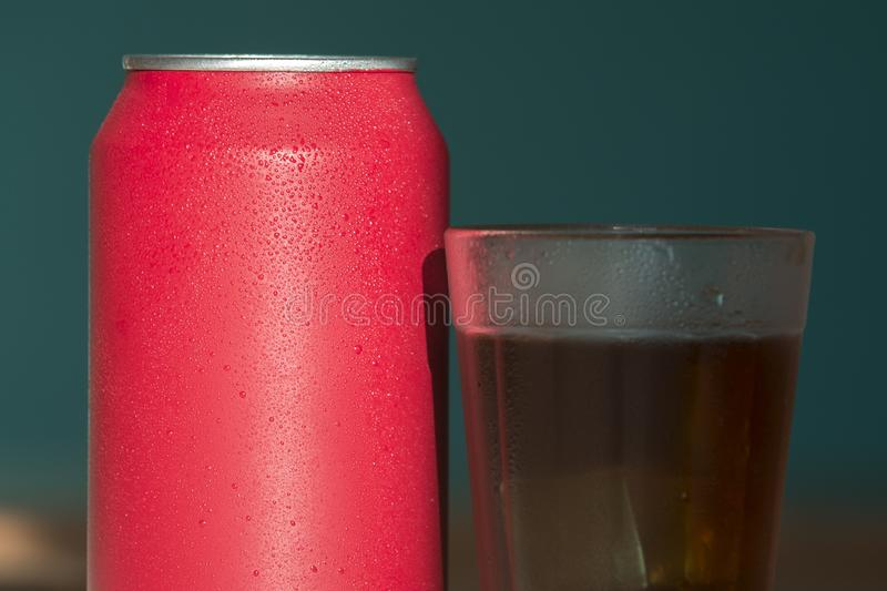 Red soda can. With a glass filled with ice dark fresh refreshing sweet drink cold cool liquid cup beverage refreshment background freshness wet still bottle royalty free stock photos