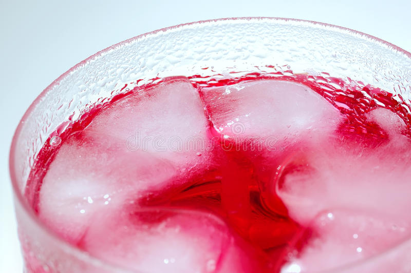 Red Soda Drinks. With ice cube in the glass stock photos