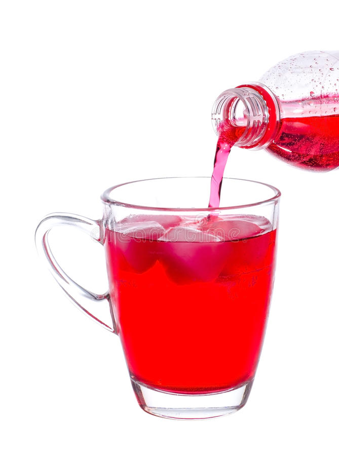 Red Soda. Pouring red soda on a glass on white background stock image
