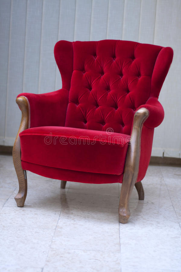 Red sofa. Old styled interior, red sofa royalty free stock photography